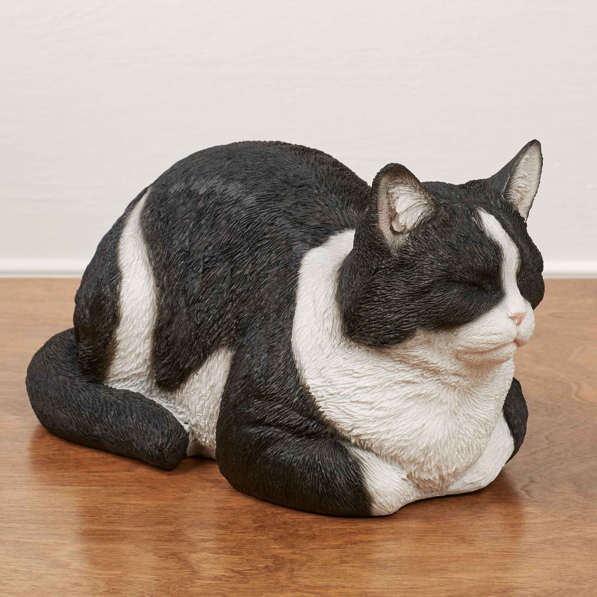 Resting Black and White Cat Sculpture